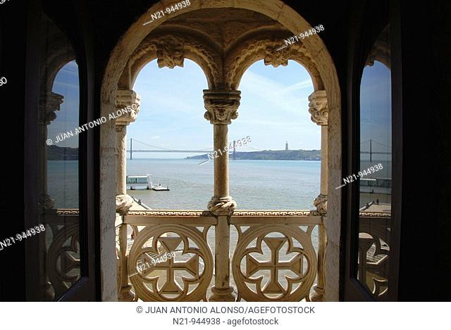 View of the Tagus river and the bridge 25 de Abril from the Rennaissance Arches of the Governor's room balcony. Torre de Belem