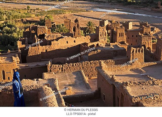 Berber Man Standing on Roof of Kasbah  Ait Benhaddou, Morocco, North Africa