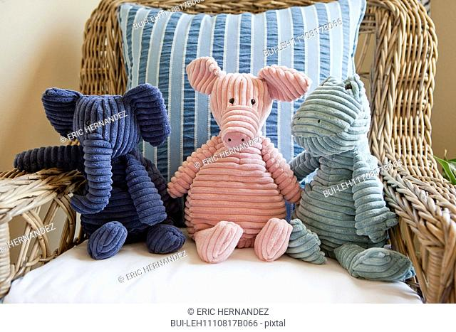 Close-up of stuffed toys on wicker armchair at home; California; USA