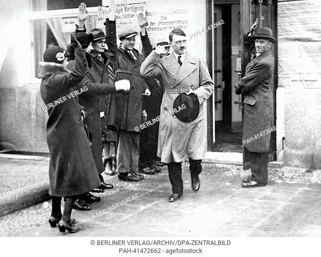 The image from the Nazi Propaganda! shows Adolf Hitler leaving a polling station in Munich, Germany, in the context of the election of the state government in...