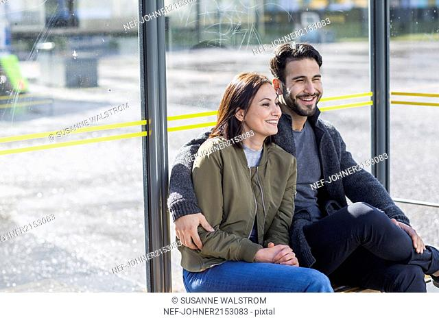 Mid adult couple on bus stop