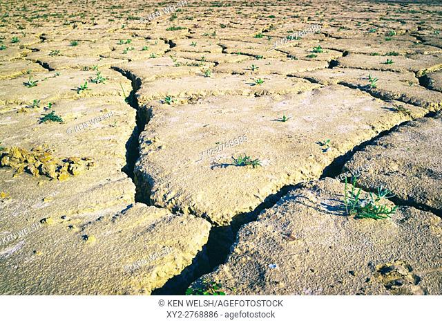 Zahara - el Gastor reservoir, Cadiz Province, Andalusia, southern Spain. Dried and cracked ground when water supply at low level