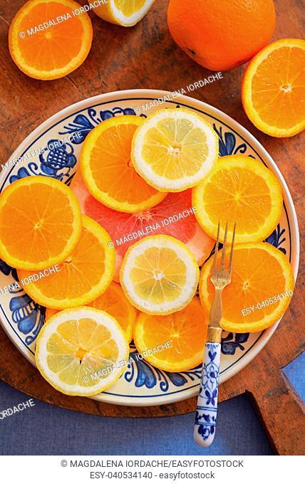 Fresh citrus fruits on vintage plate
