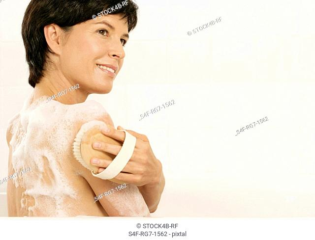 Mature woman using a brush