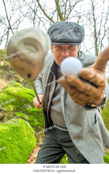 Elegant Golfer showing golf ball and Driver in Ticino, Switzerland