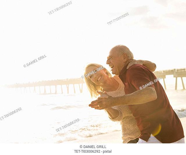 Senior couple dancing on beach