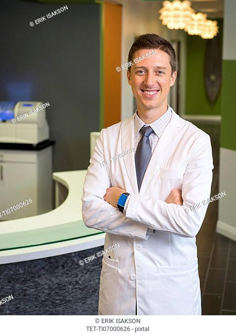 Portrait of smiling dentist
