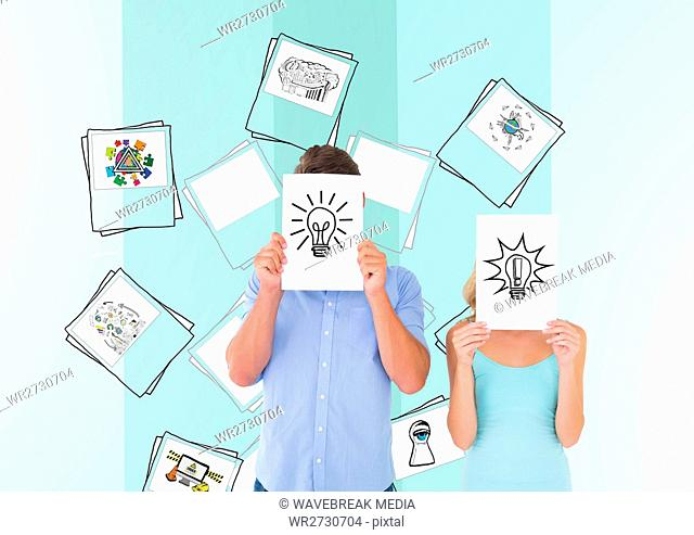 Man and woman covering their face with paper