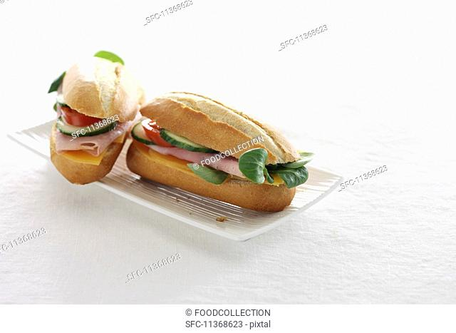 Baguette sandwiches with ham, tomatoes and cucumbers