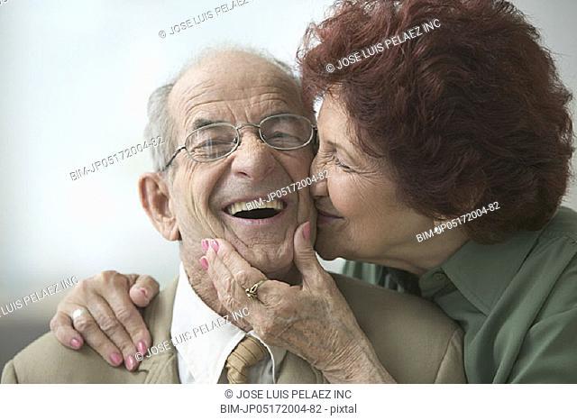 Senior couple kissing affectionately