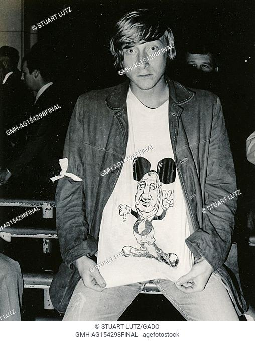 Student in hippie attire, including a t-shirt with a caricature of politician Spiro Agnew portraying Agnew as the character Mickey Mouse