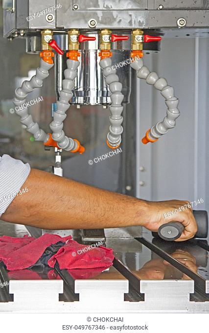 Man set up dial gauge for setting balance work  after cutting of CNC