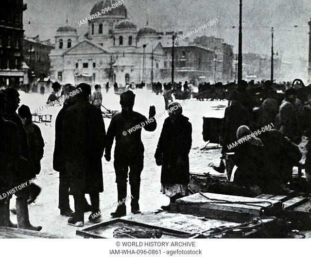 Petrograd Residents (St Petersburg) gather tto take food supplies during food shortages in the weeks before the Russian Revolution. 1917