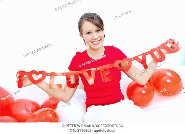 Young woman with garland I love you (model-released)
