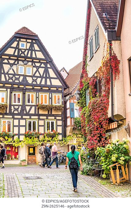 tourists in the historic city center of besigheim, baden-wuerttemberg, germany