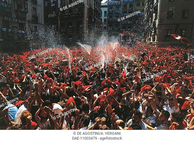The crowd during the Chupinazo (rocket lauch to begin the festival), San Fermin festival, Pamplona, Navarra, Spain