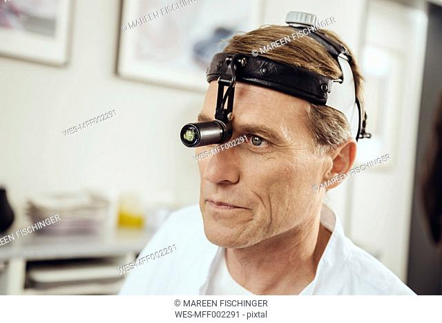 Doctor wearing surgical headlight