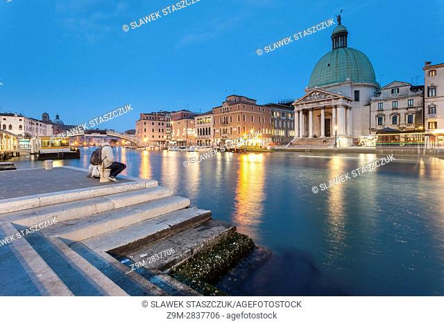 Night falls on Grand Canal in Venice, Italy. San Simeone Piccolo church in the background