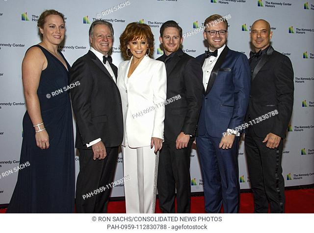 Reba McEntire arrives with her family for the formal Artist's Dinner honoring the recipients of the 41st Annual Kennedy Center Honors hosted by United States...