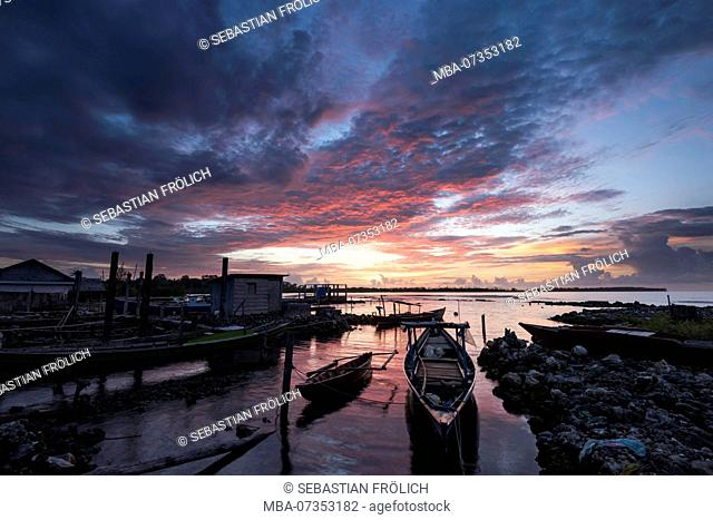 Fishing boats in the harbor of Haloban during sunset