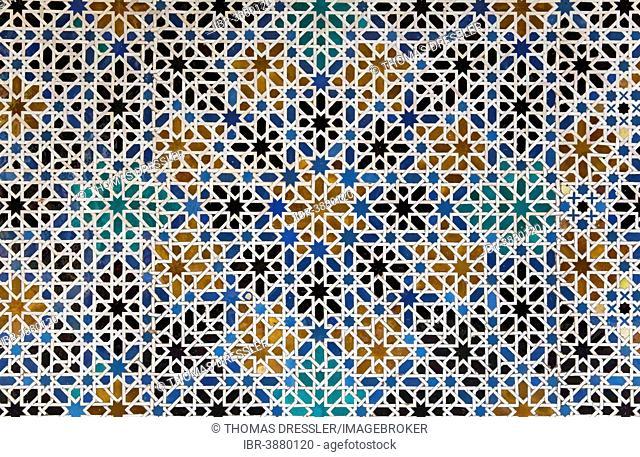 Mudéjar tiles with Moorish geometric patterns in the Alcázar of Seville, Seville province, Andalusia, Spain