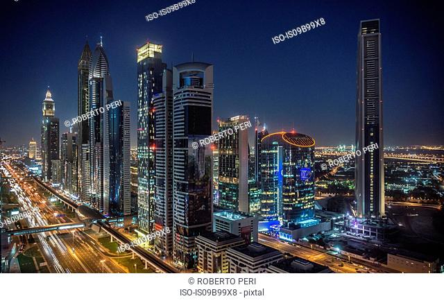 Cityscape and skyscraper skyline at night, Dubai, United Arab Emirates