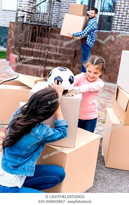 mother and daugnter having fun while moving into new house