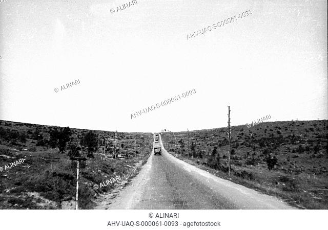 Spanish Civil War 1936-1939: A column of trucks along a long straight road, shot 1937-1939 by Lorandi Maurizio