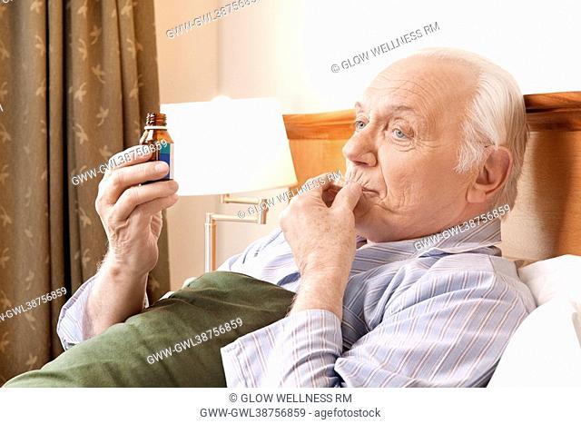Close-up of a man taking medicine