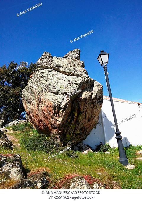 Massive granite boulder beside house. Sierra de Fuentes, Cáceres province, Spain
