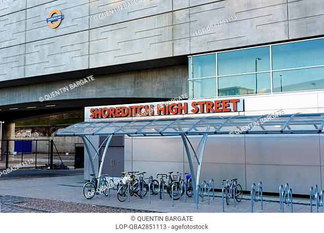 England, London, Shoreditch. A bicycle rack outside Shoreditch High Street overground railway station