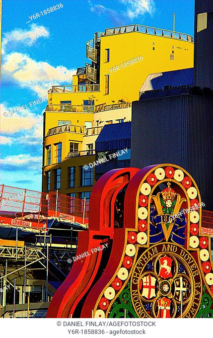 Colourful building site on London's 'south bank' of the River Thames on a fine Sunday in Summer  A Victorian railway company sign from 1834 is in the foreground