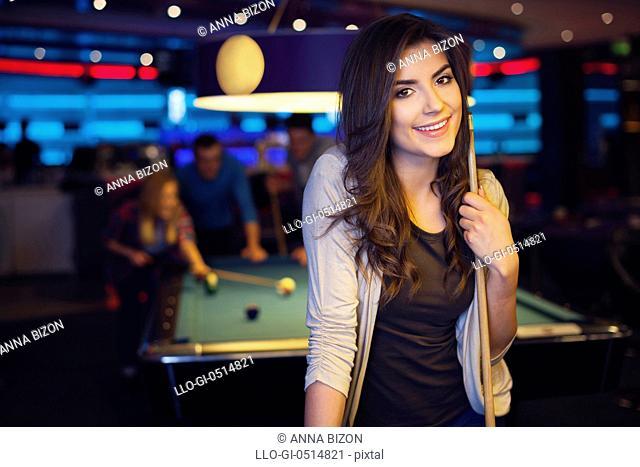 Portrait of beautiful woman in billiard club. Rzeszow, Poland