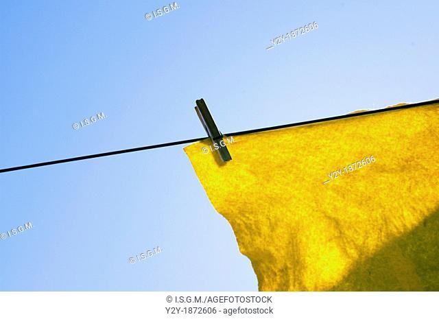 Yellow cloth under the sun
