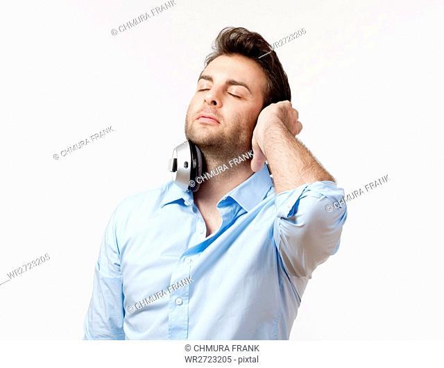 adult, audio, beat, blue, Caucasian, earphones, enjoy, entertainment, expression, face, fun, guy, headphone, headphones, hear, isolated, leisure, lifestyle