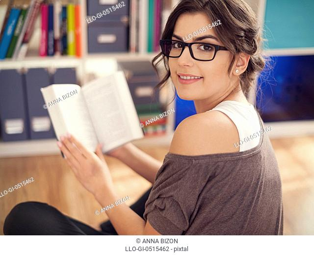 Beautiful woman reading her favourite book. Debica, Poland
