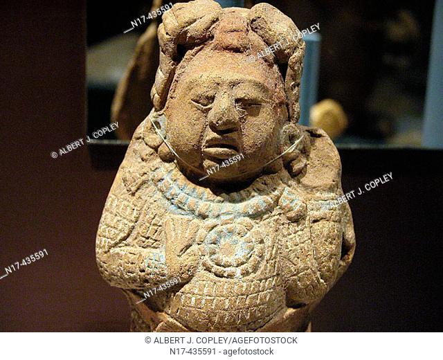 Figurine (late classic period, 550 - 900 A.D.), Maya sculpture in museum. Mérida, Yucatán. Mexico