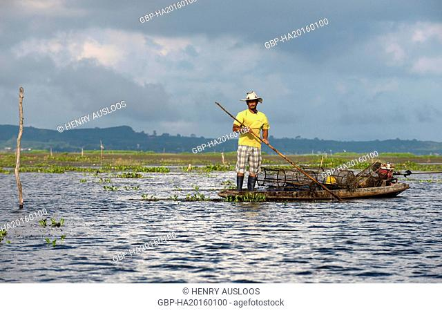 Thailand, Patthalung, Tale Noi, Fisherman on boat with fish traps