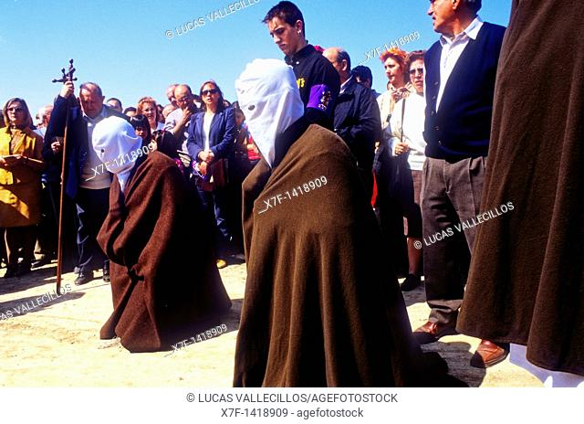 `Picaos' penitents praying in a Station of Via Crucis 'Los Picaos',Holy Week procession  Cofradia de la Santa Vera Cruz de los disciplinantes  San Vicente de la...