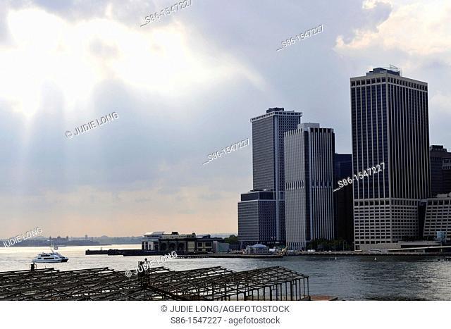 Late Day Sun Rays Over Financial Center Wall Street Harbor, New York, NY, USA