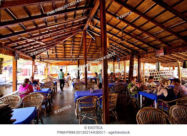 Tourists in a restaurant, Oasis Restaurant, Anjuna, North Goa, Goa, India