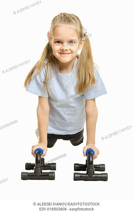 Six year old girl Europeans engaged in physical exercises