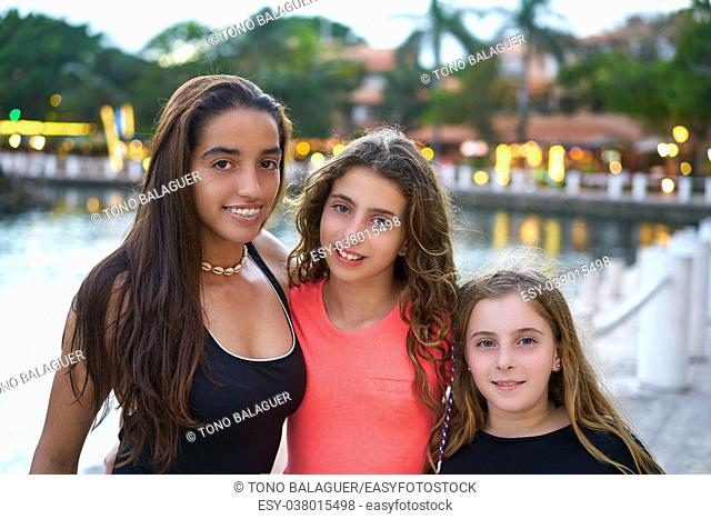 Friends girls portrait at sunset mixed ethnicity