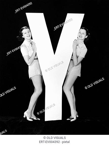 Women posing with huge letter Y All persons depicted are not longer living and no estate exists Supplier warranties that there will be no model release issues