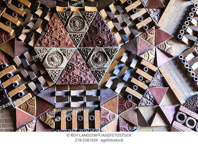 Abstract image of a decorative brick panel on an entrance wall