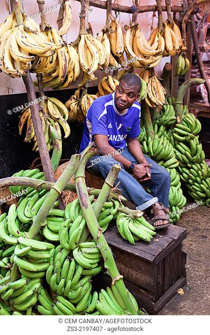 Vendor selling selling bananas at the daily market on Darajani road, Stone Town, Unguja Island, Zanzibar Archipelago, Tanzania, East Africa