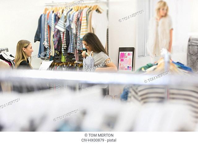 Fashion buyers examining clothing