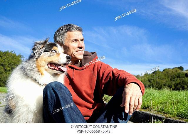 USA, California, Fairfax, Mature man with dog looking away