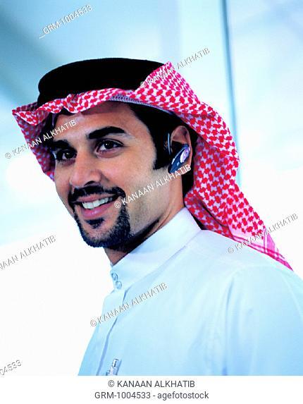 Arab businessman with Bluetooth headset