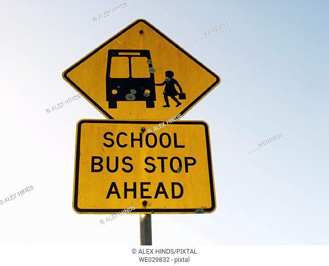School bus stop ahead. Sign
